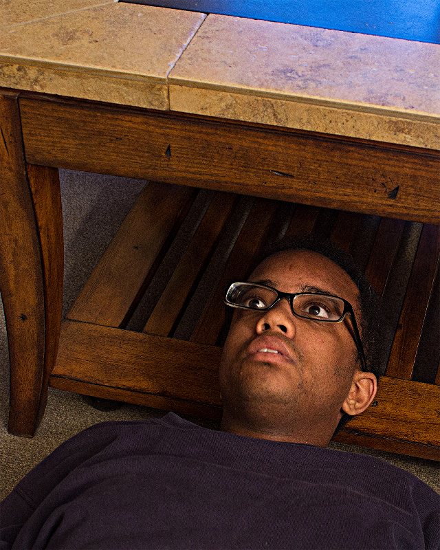 Julian Harper, self under coffee table, 2017